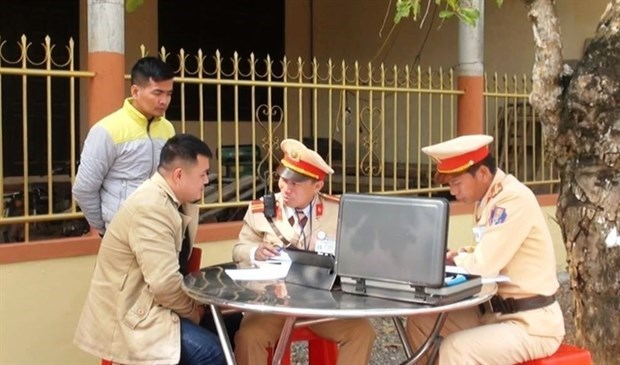Traffic fines to be collected online from March 13 hinh anh 1