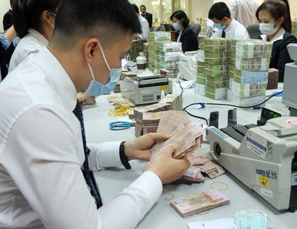 Cash to be disinfected to curb spread of COVID-19 hinh anh 1