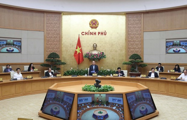 PM requests stronger countermeasures against COVID-19 hinh anh 1