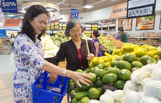 Businesses seek measures to cope with COVID-19 hinh anh 1
