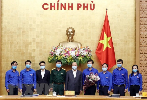 PM calls for youth's stronger engagement in COVID-19 fight hinh anh 1