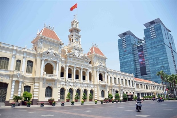 COVID-19 to pull VN's growth down to 6.3 percent: Fitch Solutions hinh anh 1
