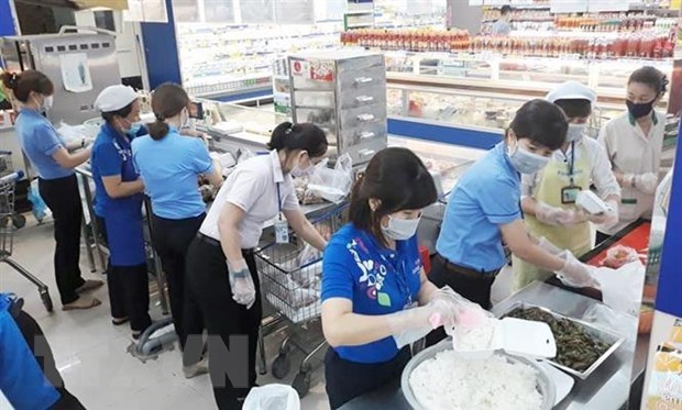 Saigon Co.op increases food portions supply to COVID-19 quarantine zones hinh anh 1