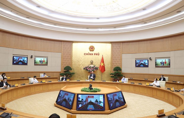 Promoting national solidarity, cooperation in COVID-19 fight: PM hinh anh 1