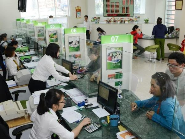 Reference exchange rate down 5 VND on April 6 hinh anh 1