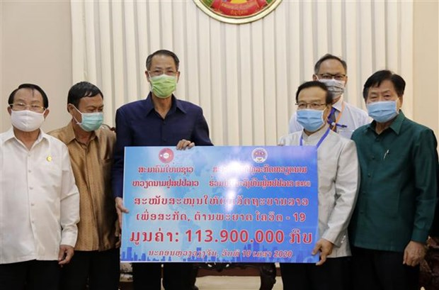 Vietnamese expat community support Laos in battling COVID-19 hinh anh 1