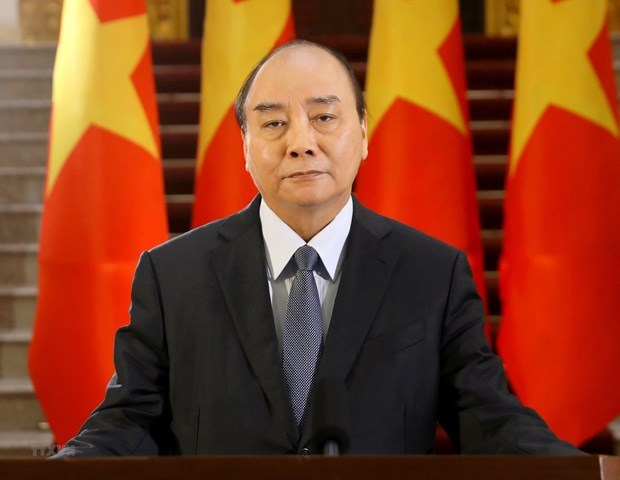 PM calls on expats to keep joining nation's efforts in pandemic combat hinh anh 1