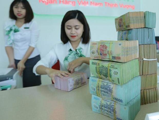 Credit declines in first half of April due to COVID-19 pandemic hinh anh 1