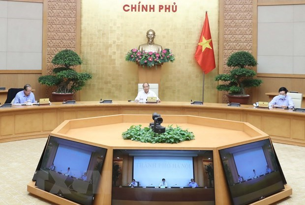 PM agrees to designate Hanoi a COVID-19 risk area, down from high-risk hinh anh 1