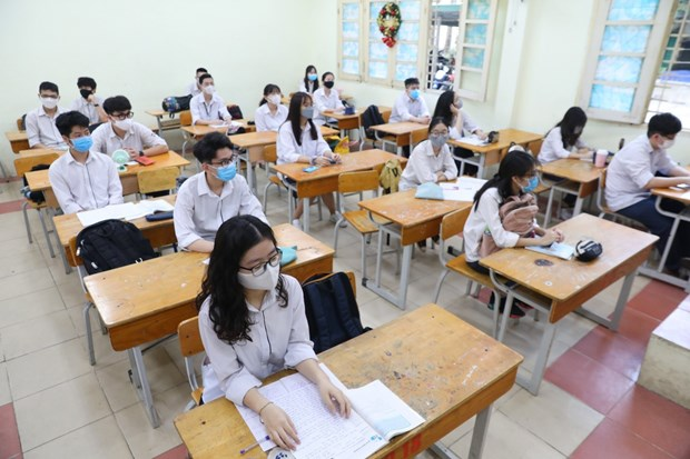 Tens of millions of students back to school after long COVID-19 break hinh anh 1