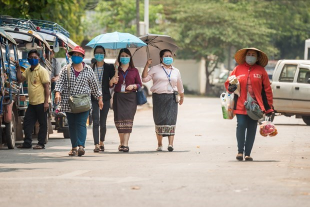 Laos issues temporary guideline on entry-exit hinh anh 1