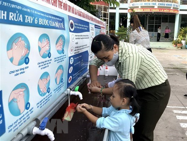 Vietnam records no new COVID-19 infections in community for 26 days hinh anh 1