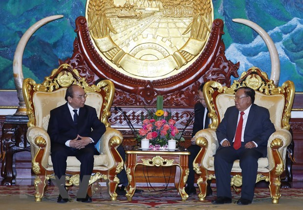 PM Nguyen Xuan Phuc attends state funeral of former Lao PM hinh anh 2