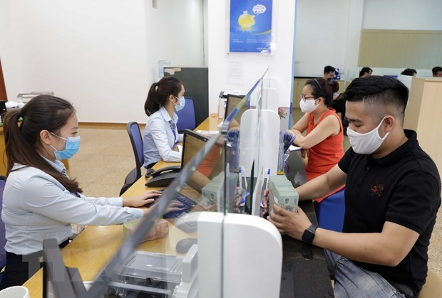 Banks aid 318,000 COVID-19 affected borrowers hinh anh 1