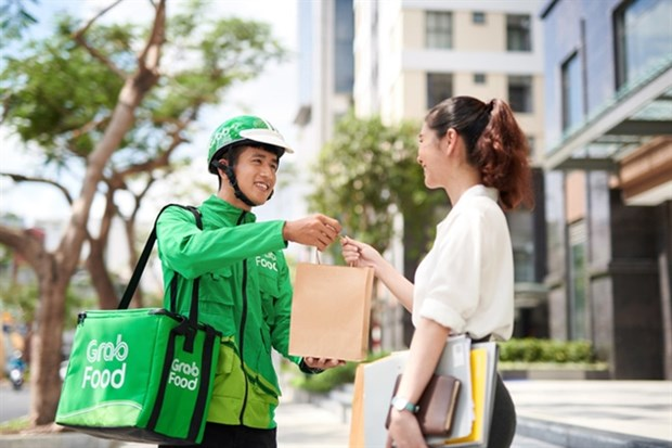 Grab Food takes biggest bite of food delivery in Vietnam: survey hinh anh 1