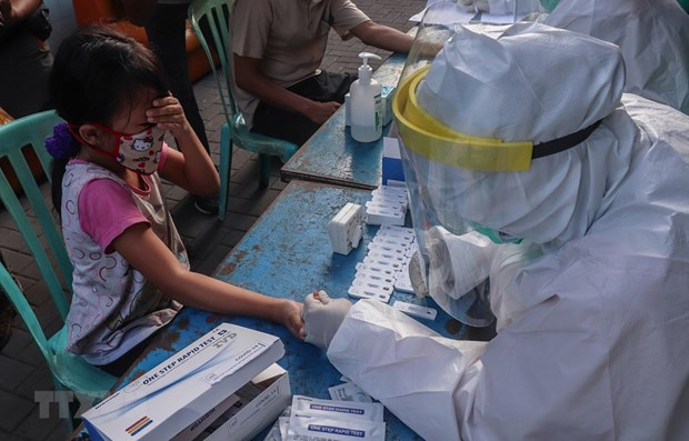 Southeast Asian countries report hundreds of new COVID-19 patients hinh anh 1