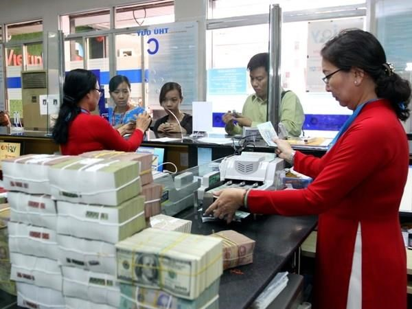 Reference exchange rate down 10 VND on June 11 hinh anh 1