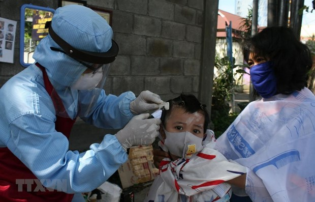 Southeast Asian countries still record hundreds of new COVID-19 cases hinh anh 1