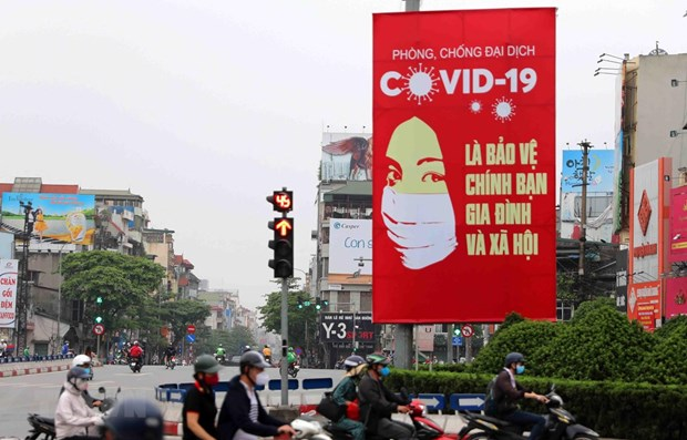 Russian expert: Posters a weapon in Vietnam's COVID-19 fight hinh anh 1
