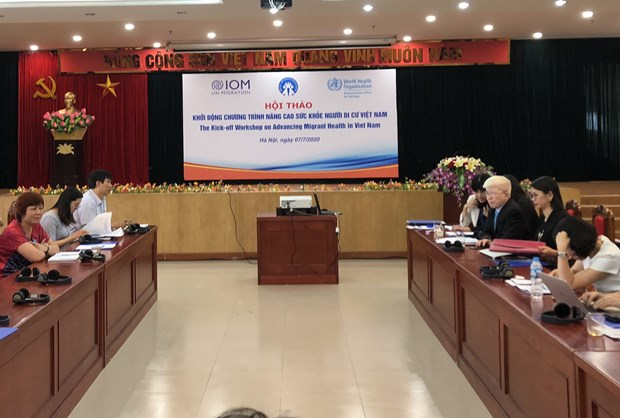 Symposium talks improving migrants' health hinh anh 1