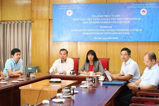 Vietnam shares experience in fighting COVID-19 with Canada hinh anh 1