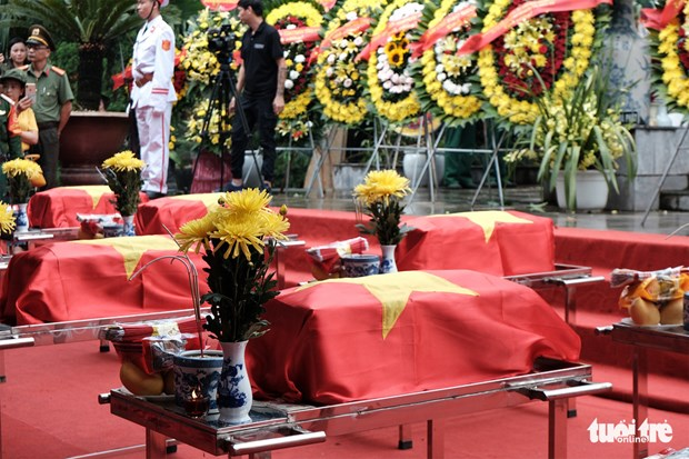 Martyrs' remains reburied at Vi Xuyen National Martyrs' Cemetery hinh anh 1