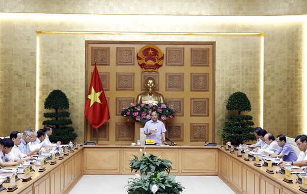 PM demands continued restructuring of credit organisations hinh anh 1