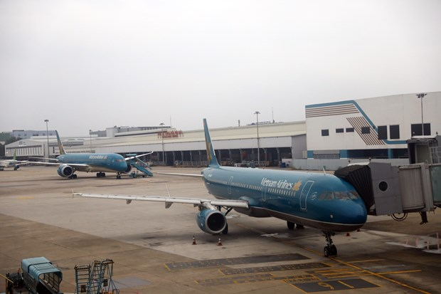 Vietnam Airlines applying stricter pandemic prevention measures: official hinh anh 1