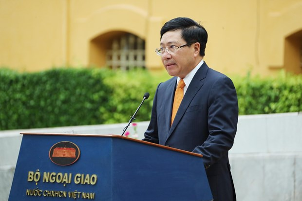 Speech by Deputy PM Pham Binh Minh at ASEAN flag hoisting ceremony hinh anh 1