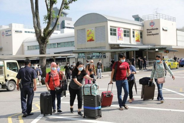 Malaysia, Singapore resume cross-border travel hinh anh 1