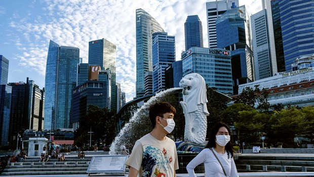 Nearly 60 percent of Singaporean firms need 1-2 years to recover hinh anh 1