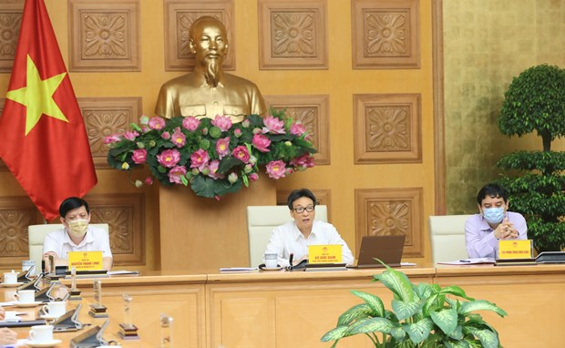 COVID-19 outbreak in Da Nang, Quang Nam under control: acting health minister hinh anh 1
