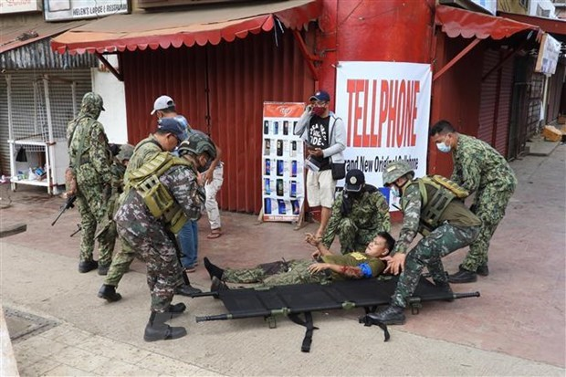 Vietnam strongly condemns terrorist bombings in Sulu, Philippines hinh anh 1