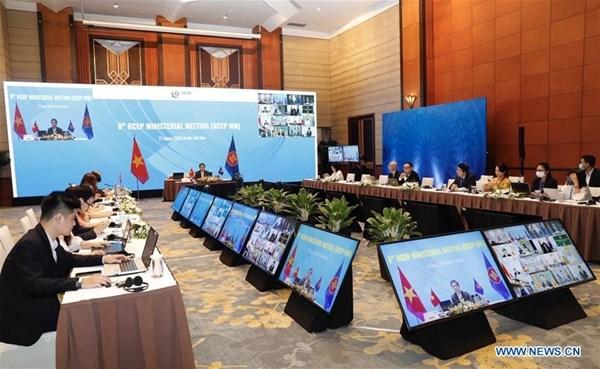 ASEAN, China laud bilateral trade-investment growth despite pandemic hinh anh 1