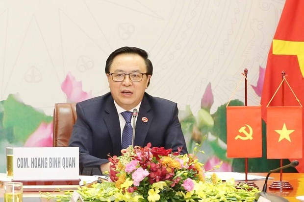 Vietnamese, Lao Party officials hold online talks hinh anh 1