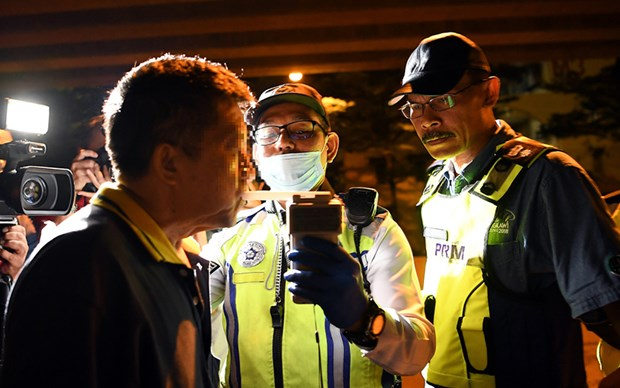 Malaysia imposes tougher penalty for drink-driving hinh anh 1
