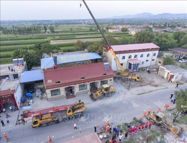 Sympathy to China over building collapse hinh anh 1