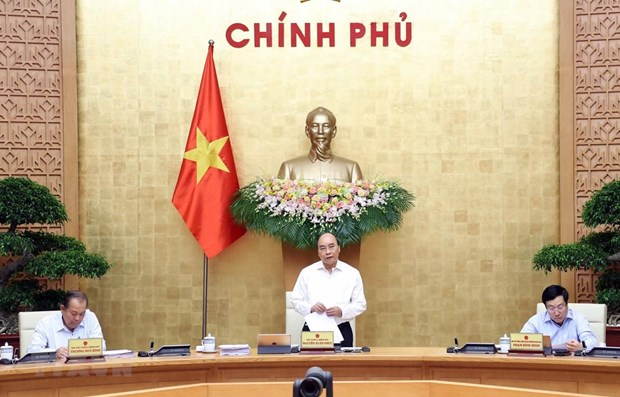 PM requests economic stimulation, inflation control hinh anh 1