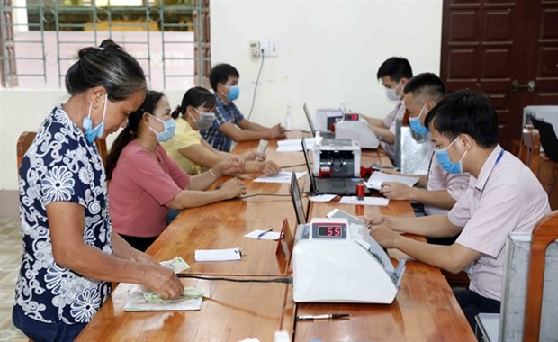 SBV tells banking industry to develop an inclusive finance system hinh anh 1