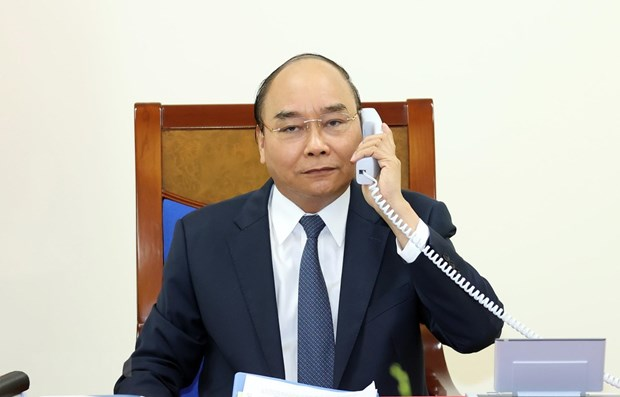 Vietnamese PM, German Chancellor hold phone talks hinh anh 1