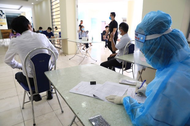 Vietnam reports two imported COVID-19 cases on October 11 hinh anh 1