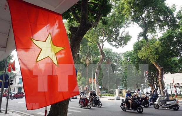 Vietnam's COVID-19 control fuels economic growth: expert hinh anh 1