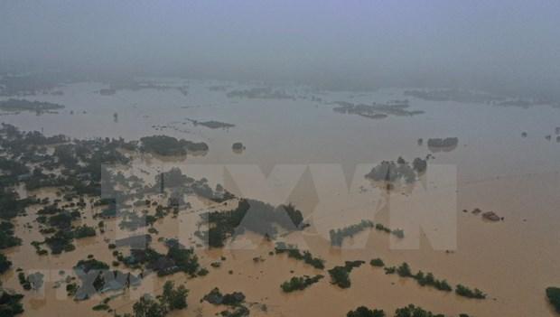 Record flooding kills 84 in central region so far hinh anh 1