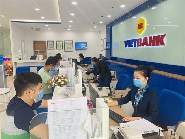 Banks in HCM City to continue supporting businesses hinh anh 1