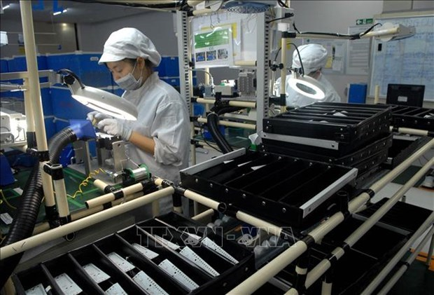 Political commitment key to Vietnam's FDI attraction achievement: expert hinh anh 1