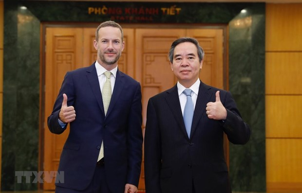 Party official receives head of US finance corporation hinh anh 1