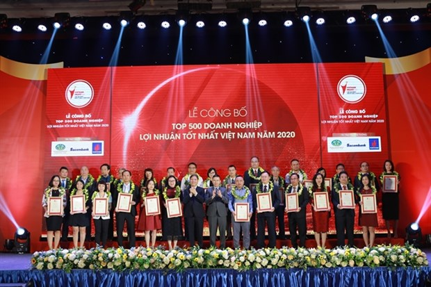 Local firms expect modest growth due to COVID-19 hinh anh 1
