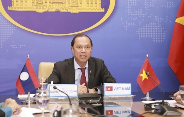 Deputy ministerial-level Vietnam-Laos political consultation held hinh anh 1