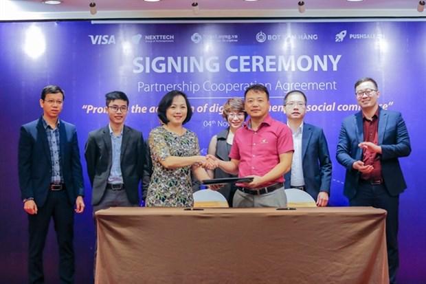 Visa, NextTech Group sign three-year partnership hinh anh 1
