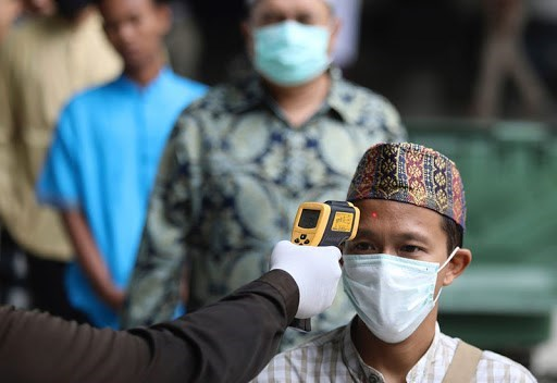 Southeast Asian countries record thousands of new COVID-19 cases hinh anh 1